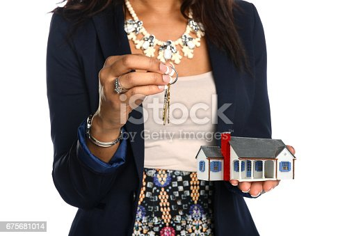 istock Female Agent Holding House and Keys 675681014