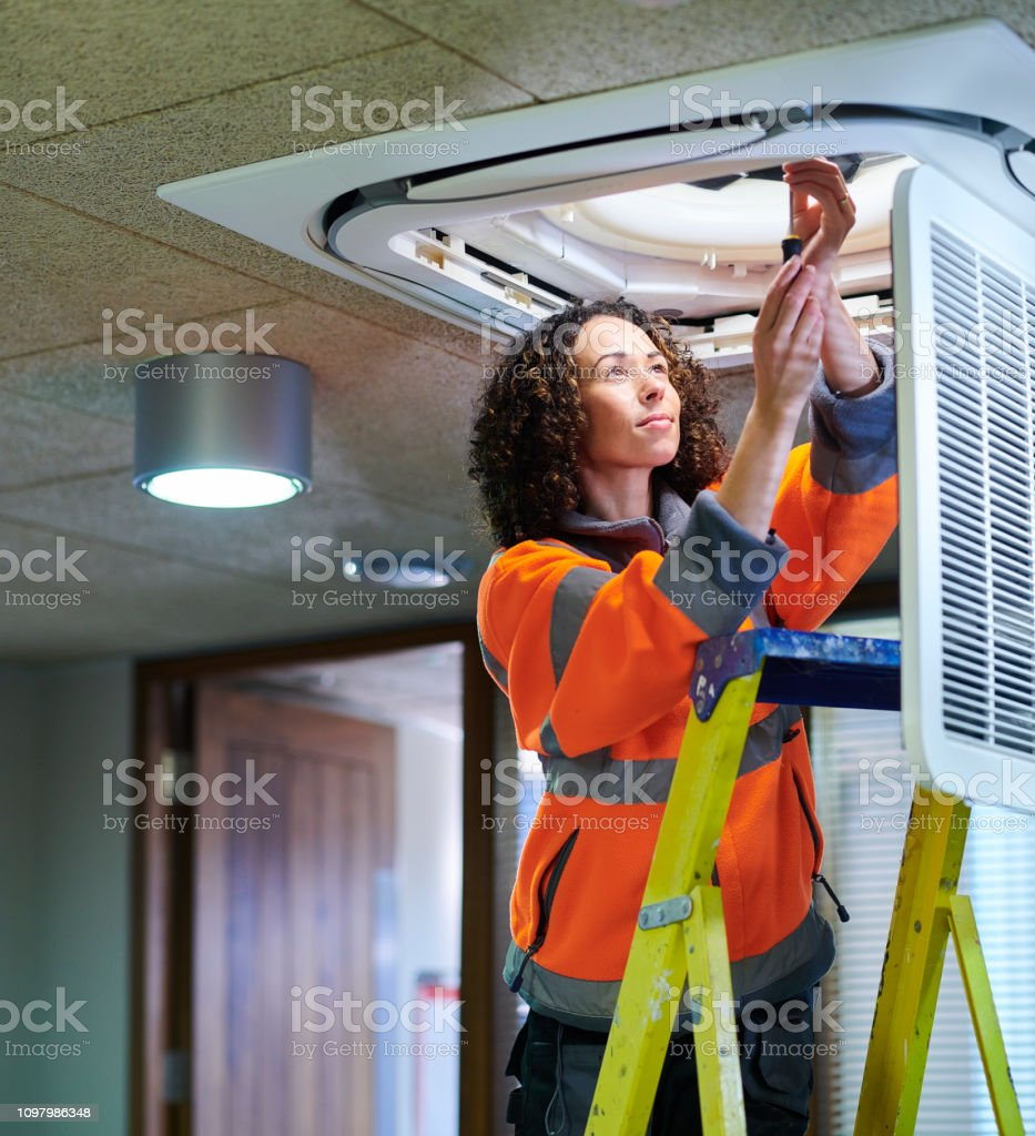 female air con maintenance engineer stock photo