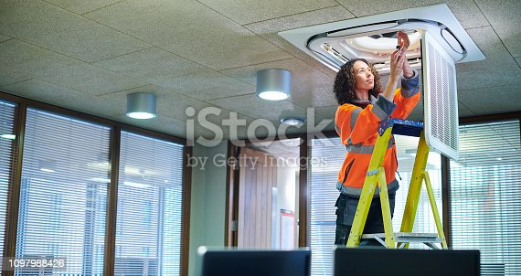 air con maintenance engineer in empty office floor