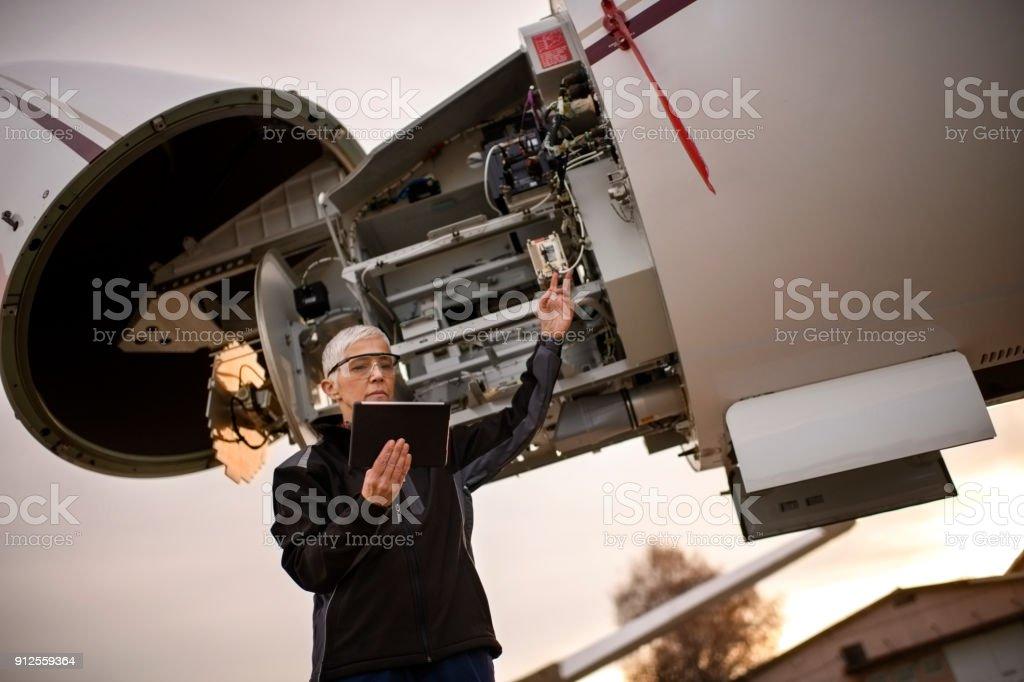 Female aircraft mechanic stock photo
