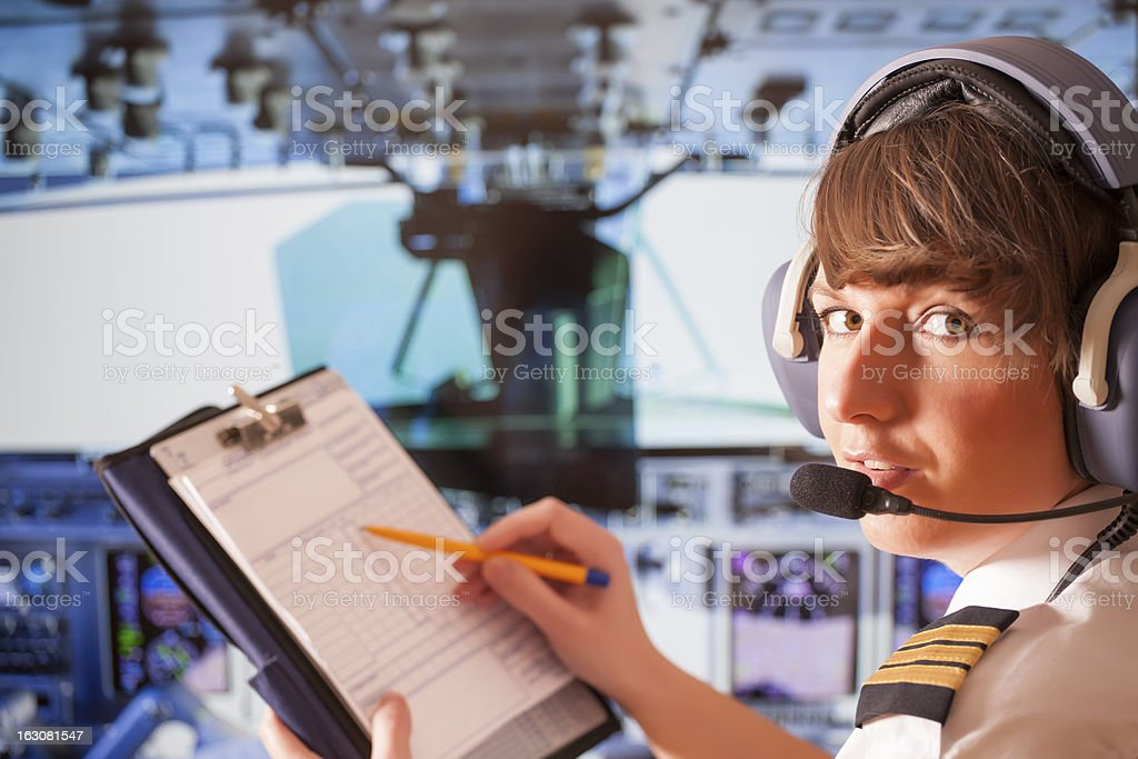 Female airplane pilot with a clipboard stock photo