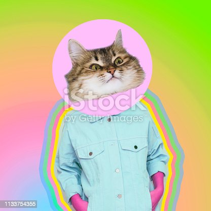 istock Female alien model with cat face instead head on gradient background. 1133754355
