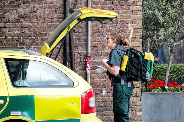 Female Ambulance Paramedic, Rapid Response Vehicle. stock photo