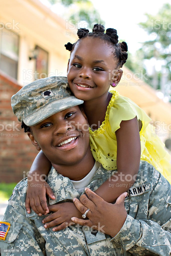 Female American Soldier and Daughter stock photo