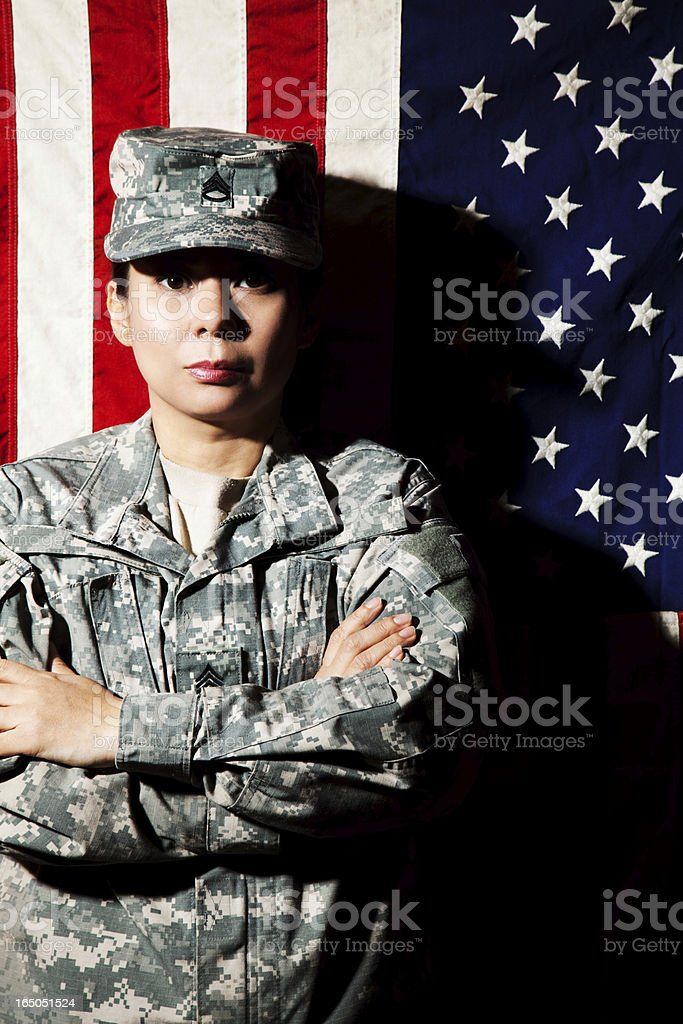 Female American Soldier in Army Camouflage Uniform stock photo