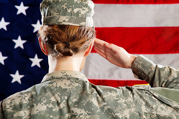 female  american soldier series: saluting - saluting stock photos and pictures