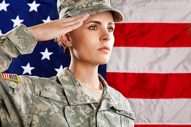 female american soldier series:against usa flag - saluting stock photos and pictures