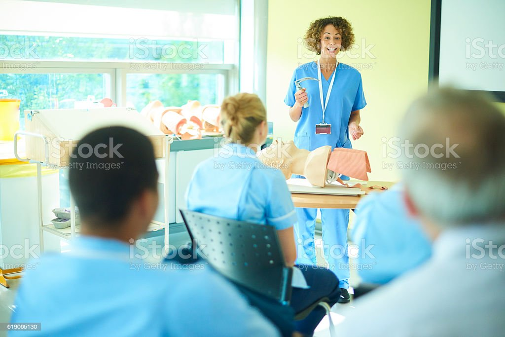 female anaesthetist with nursing class stock photo