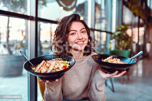 istock Female And Her Salad Choice 1203046940