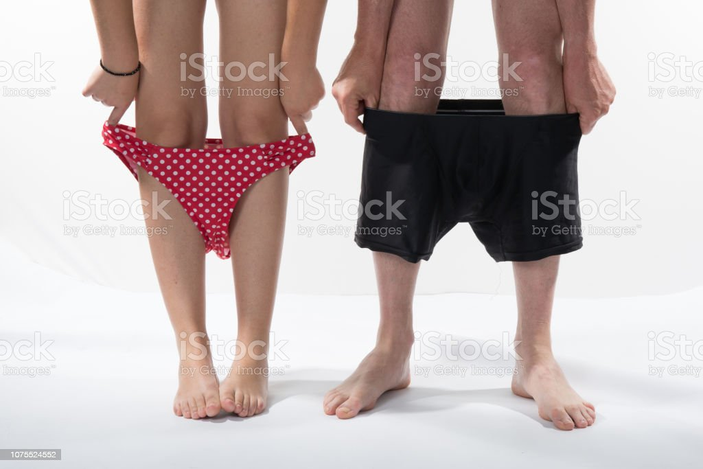 Female and male legs with swim suits. Couple in love having a date