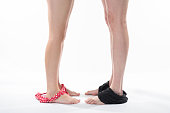 Female and male legs with swim suits. Couple in love standing together.