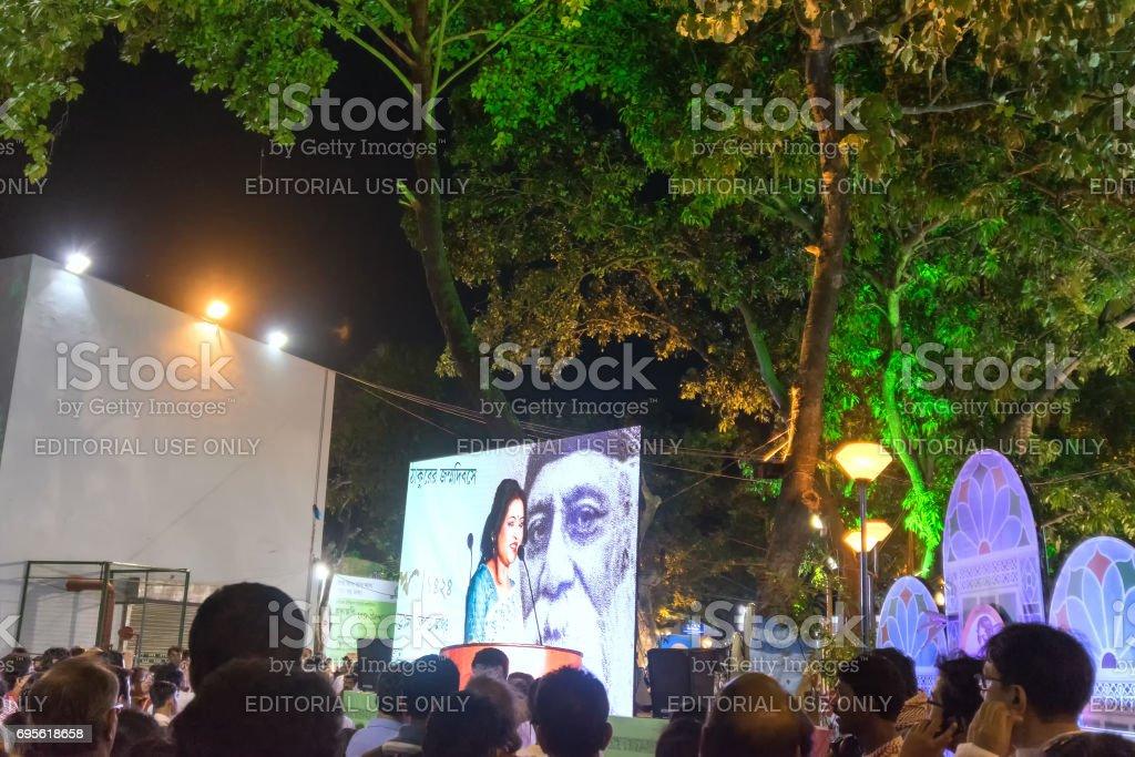 A female announcer is seen in big screen amongst audience, Rabindra Jayanti, Kolkata stock photo