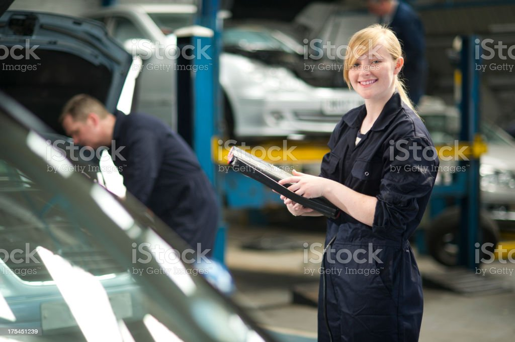 female apprentice mechanic stock photo