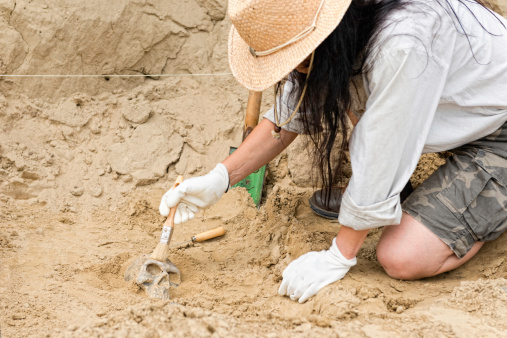 istock Female archaeologist making discoveries 464319979