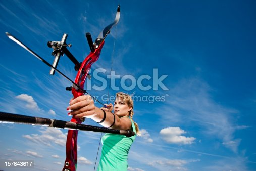 istock A female archer getting ready to release the arrow 157643617