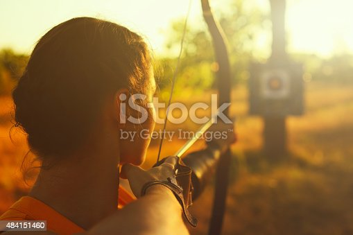 istock Female archer in the field at sunset 484151460