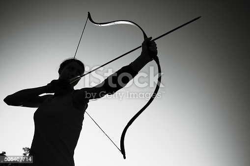 istock Female archer in the field at sunset 505407714