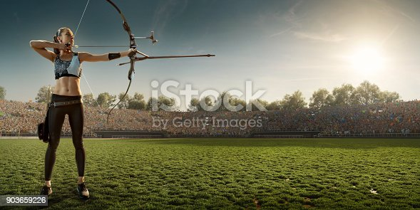 istock Female archer shooting with the longbow at sunset 903659226