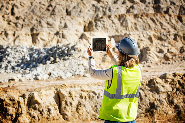 Female architect photographing quarry stock photo