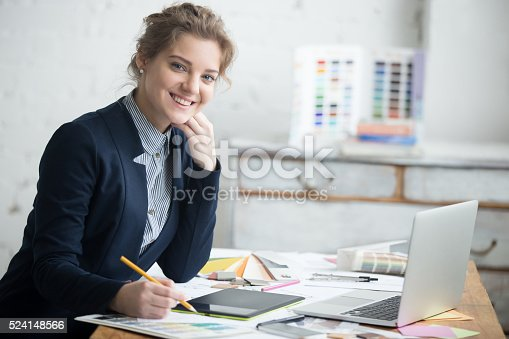 istock Female architect posing in office 524148566