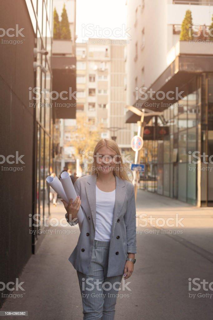 Successful businesswoman on street walking.