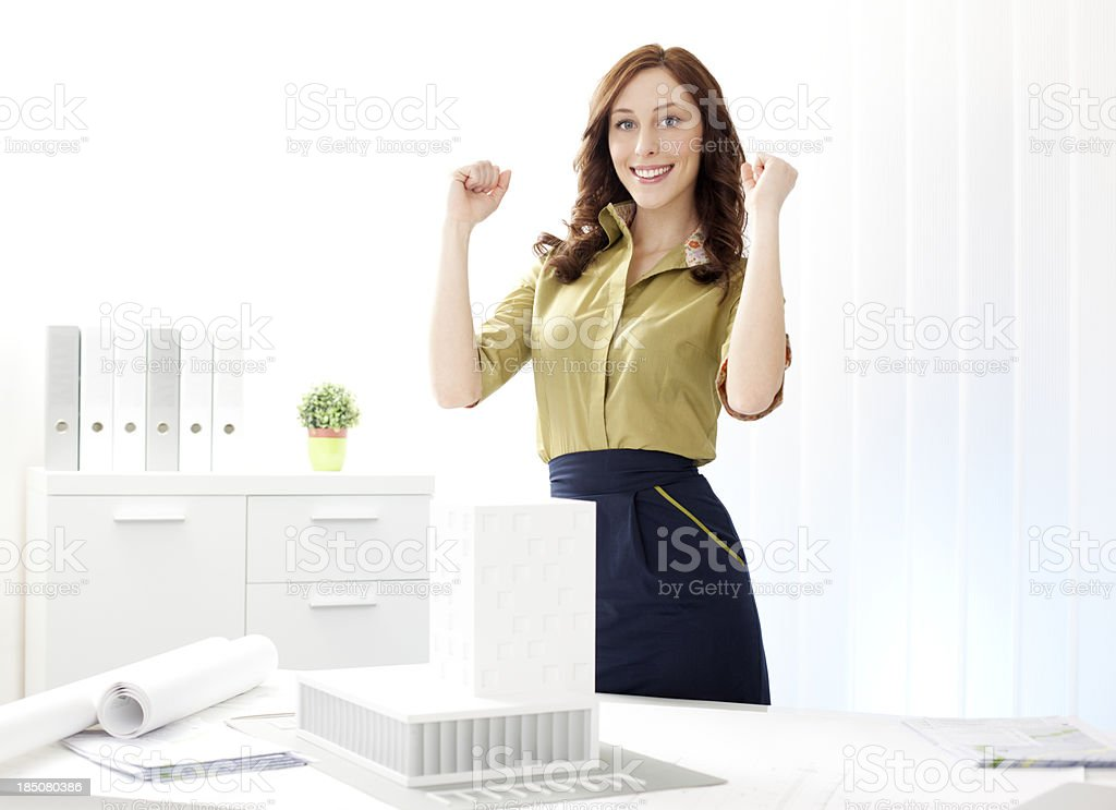 Female Architect with Architectural Model smiling at office. royalty-free stock photo