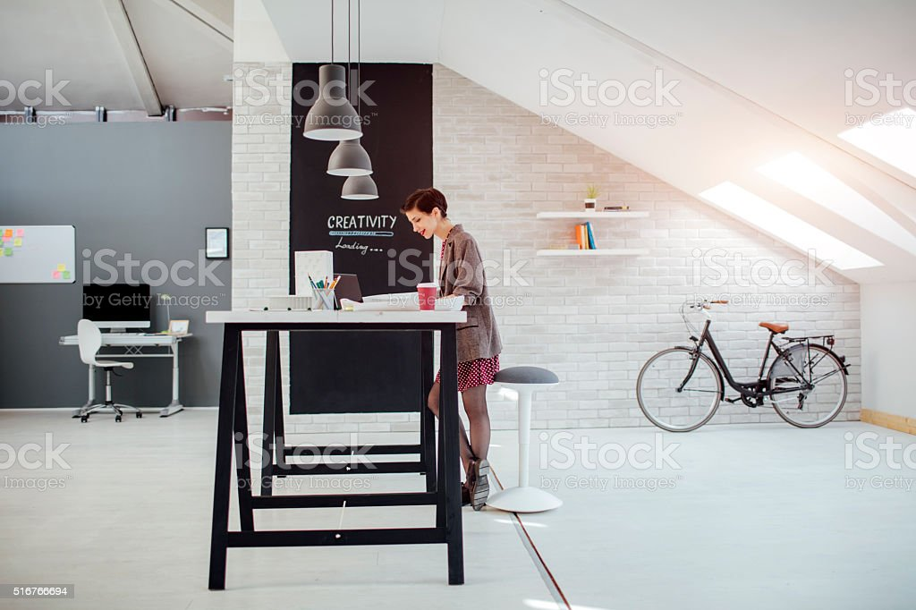Female Architect Working In Her Office stock photo