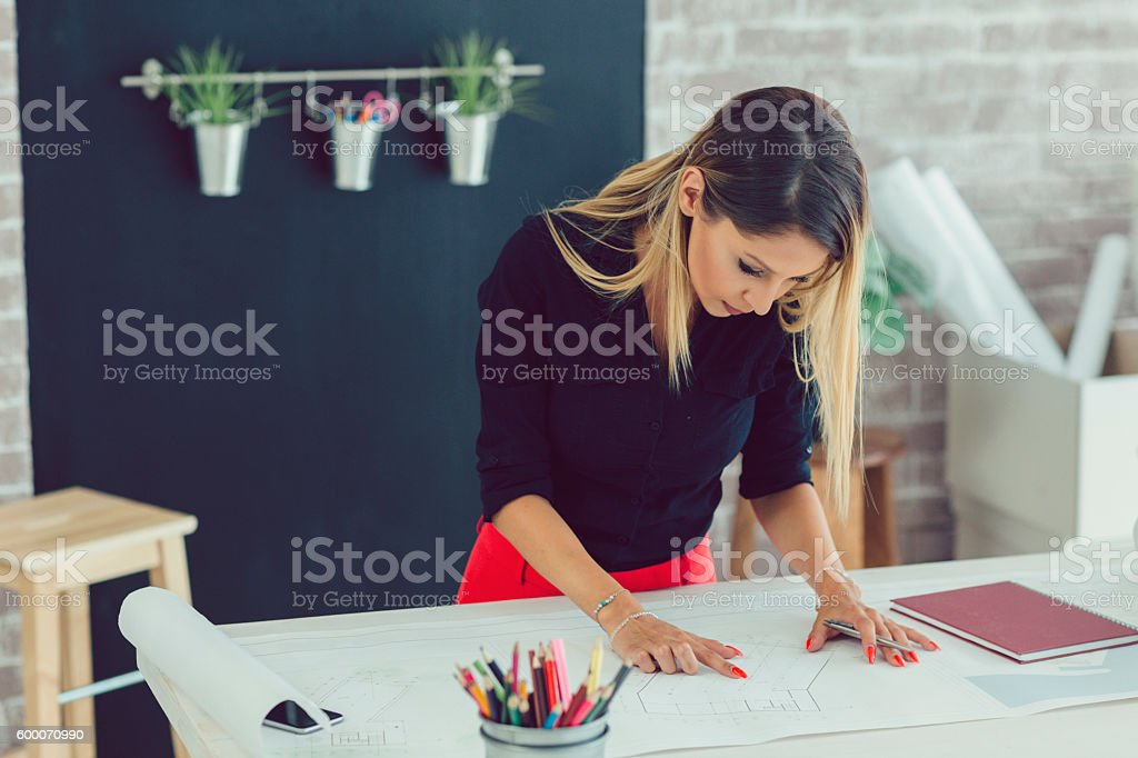 Female Architect Working In Her Office. stock photo
