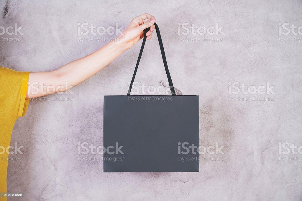 Female arm holding bag stock photo