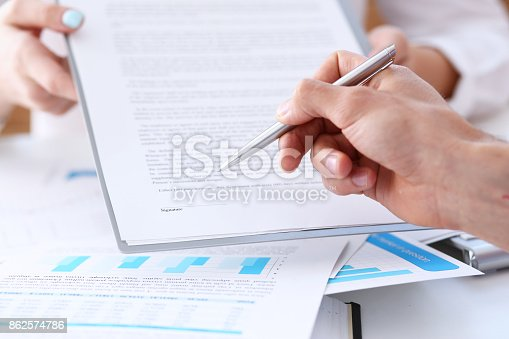 863148614istockphoto Female arm in suit offer contract form on clipboard pad 862574786