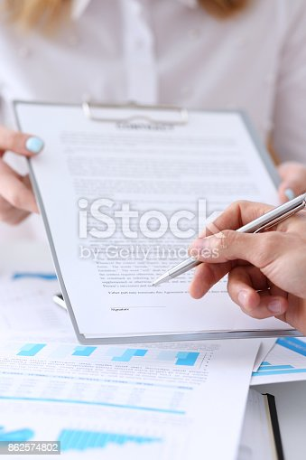 863148614istockphoto Female arm in suit offer contract form on clipboard pad 862574802