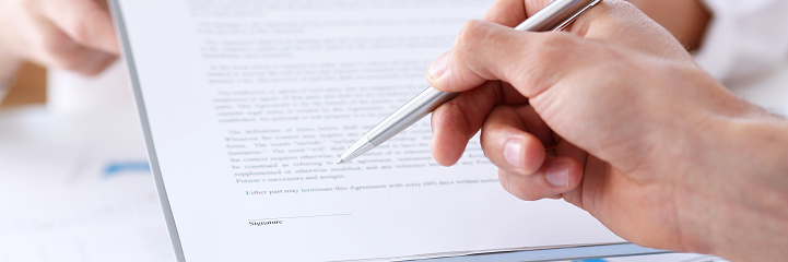 863148614 istock photo Female arm in suit offer contract form on clipboard pad 871428144