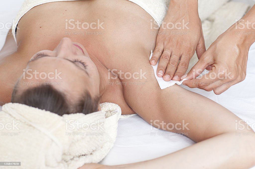 Female armpit depilation in a beauty salon stock photo