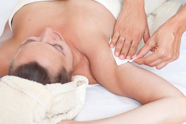 Female armpit depilation in a beauty salon stock photo