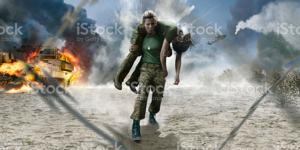 Female Army Medic Soldier Carrying Wounded Soldier From Desert ...