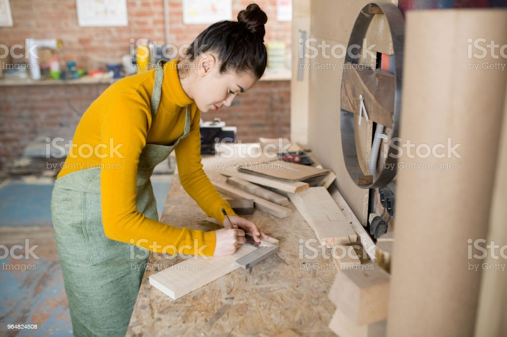 Female Artisan Working with Wood royalty-free stock photo