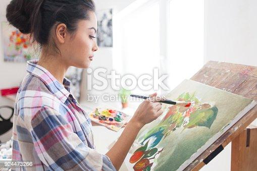 istock Female artist drawing in studio 924473266