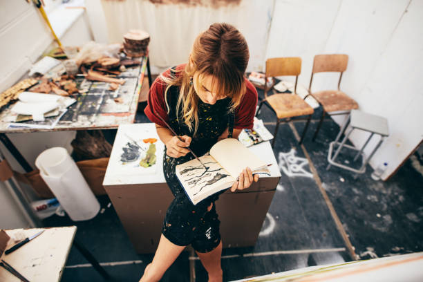 Female artist drawing pictures in her workshop stock photo
