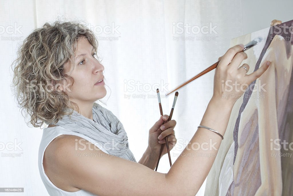 Female artist painting a picture. royalty-free stock photo