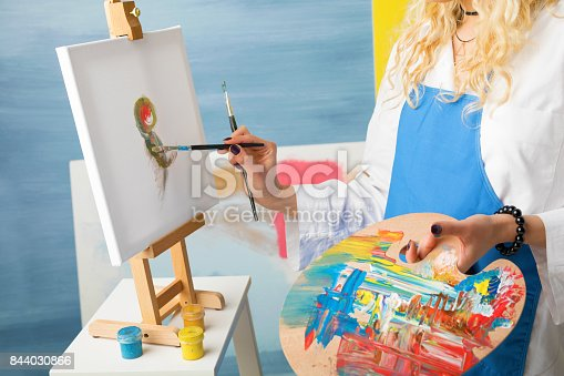 istock Female artist painting a picture 844030866