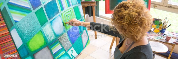 istock Female artist painting abstract painting 1088820628