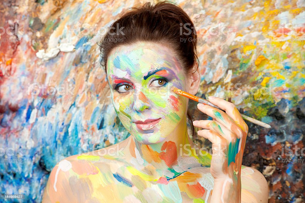 Female artist painting herself royalty-free stock photo
