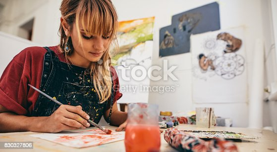 istock Female artist painting in studio 830327806