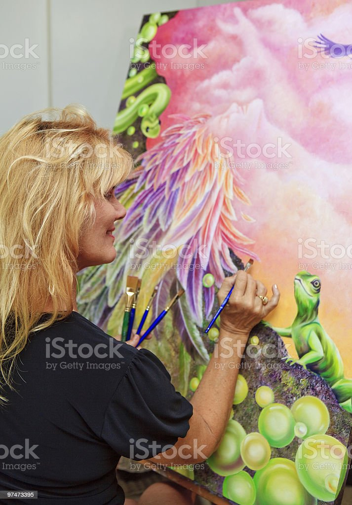 female artist painting with oil on canvas royalty-free stock photo