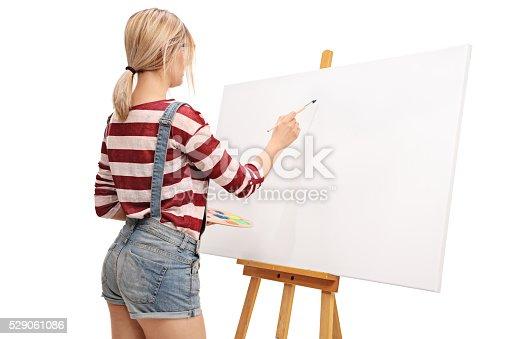istock Female artist preparing to start painting 529061086
