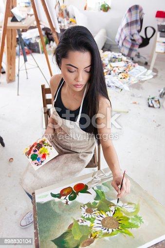 istock Female artist working in studio 898830104