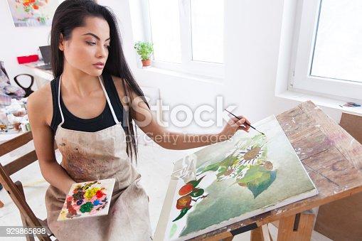 istock Female artist working in studio 929865698