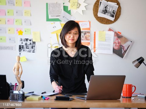 Asian female creative working from home.