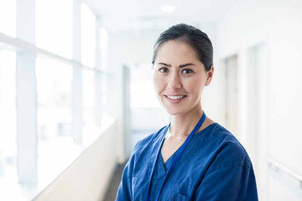 female asian nurse smiling towards camera, portrait - australian nurses stock photos and pictures