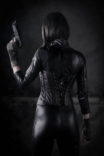 Female Assassin with gun stock photo